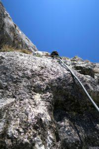 Boris in der zweiten Seillänge; mitunter war der Fels noch ziemlich nass.